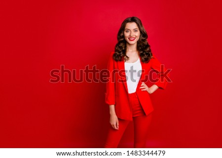 Portrait of elegant lady looking with toothy smile wearing suit isolated over red background #1483344479