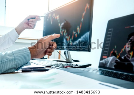Business Team Investment Entrepreneur Trading discussing and analysis finance market graph stock market trading,stock chart concept #1483415693