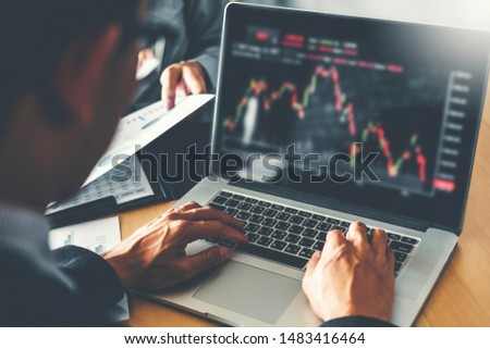 Business Team Investment Entrepreneur Trading discussing and analysis graph stock market trading,stock chart concept #1483416464