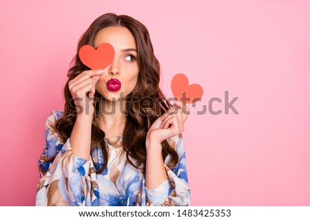 Close-up portrait of her she nice-looking attractive lovely coquettish cheerful cheery wavy-haired girl holding in hands two small little heart sending you kiss isolated over pink pastel background Royalty-Free Stock Photo #1483425353