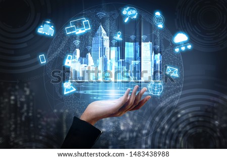 Smart technology in modern city communication with graphic interface showing concept of digital transformation, internet of things (IOT), smart wireless and information communication technology (ICT). #1483438988