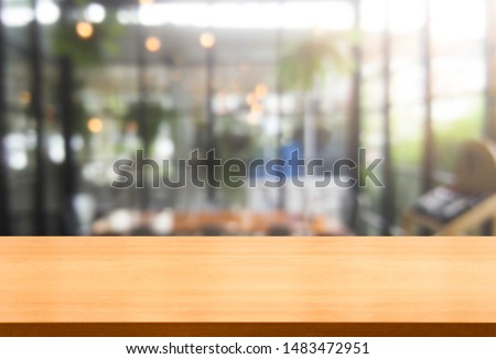 Wood table in blurry background of modern restaurant room or coffee shop with empty copy space on the table for product display mockup. Interior restaurant counter design concept. #1483472951