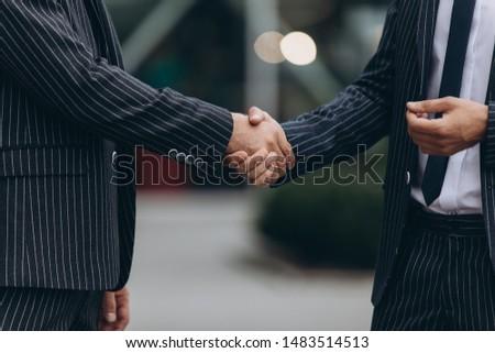 Business partnership meeting concept. Image businessmans handshake. Successful businessmen handshaking after good deal. #1483514513