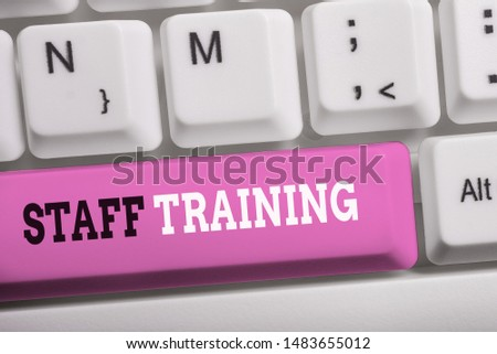 Word writing text Staff Training. Business concept for program that helps employees learn specific knowledge White pc keyboard with empty note paper above white background key copy space. #1483655012