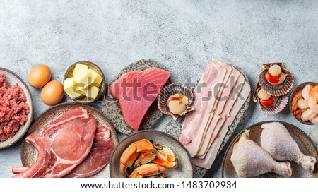 Selection food for CARNIVORE DIET. Seafood, Meat, megs and fat. Zero carbs diet concept. Royalty-Free Stock Photo #1483702934