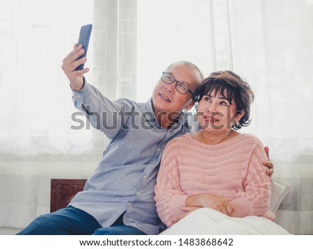 Old couples are taking pictures together #1483868642