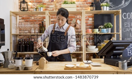Barista woman worker pouring coffee through filter in modern cafe. young girl bartender working in wooden counter and preparing customer order with drinks and croissant. waitress work in cafeteria #1483870739