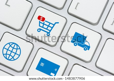 Online shopping / ecommerce and retail sale concept : Shopping cart, delivery van, credit card, world globe logo on a laptop keyboard, depicts customers order things from retailer sites using internet #1483877906