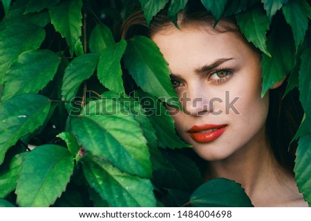 Cheerful beautiful woman red lips make-up green leaves charm #1484004698