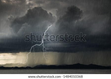 Ominous rain clouds and lightning,Black and White Dark Cloud in Rainy Season