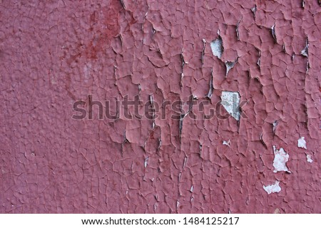 The walls of the old house red color cracked. cracked plaster as a background or texture. Old painting cracked. #1484125217