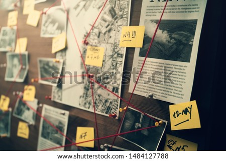 Detective board with photos of suspected criminals, crime scenes and evidence with red threads, selective focus, retro toned #1484127788