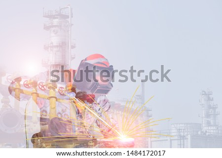 Double exposure Industry worker at the factory welding close up construction on structure oil refinery plant background. #1484172017