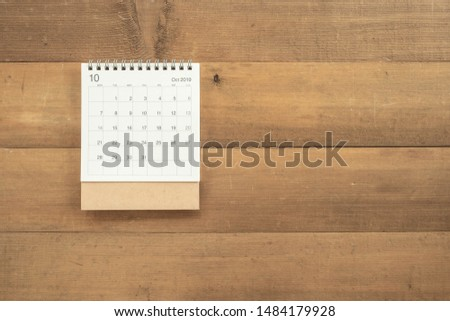 Calendar October 2019 on wooden background with copy space #1484179928