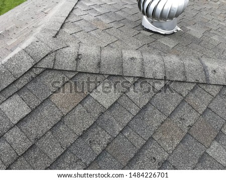 Roof Showing Hail Damage Inspection Royalty-Free Stock Photo #1484226701