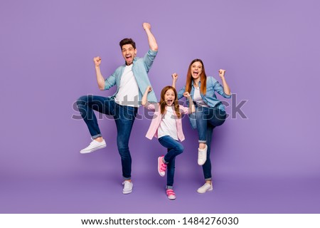Full length photo of rejoicing dad mom and little foxy lady cool win wear casual clothes isolated purple background #1484276030