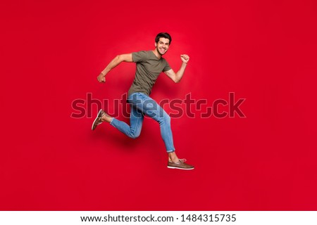 Full size photo of champion guy jumping high came first to finish wear casual outfit isolated on red background
