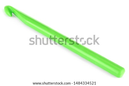 Close-up of green plastic crochet hook isolated on white background #1484334521