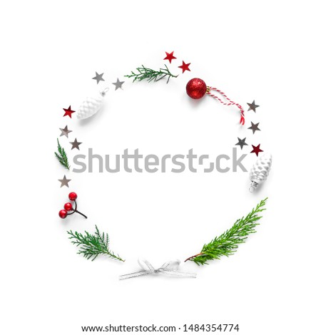 Christmas composition with round copy space. Christmas ornaments, fir branches, silver and red stars  isolated on white background. Flat lay, top view. #1484354774