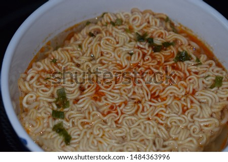 Chinese noodles in a white bowl #1484363996
