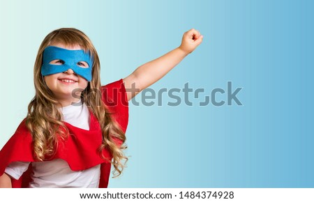 Little child superhero with yellow cloak and star. Happy smiling kid in glasses ready for education. Success, motivation concept. Back to school. Little businessman isolated on blue, Boy superhero. #1484374928
