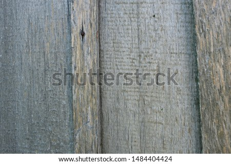 Old, gray weathered boards. A fence of retro bars. Texture background. Сlose-up. Horizontal. #1484404424