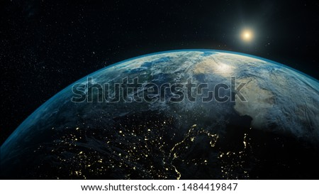 Space view of the sun rising on planet Earth, going from night to day with cloud formations and city lights  #1484419847