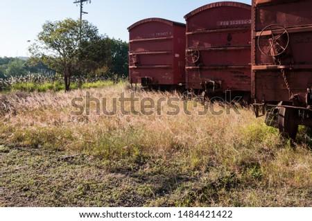 Abandoned wagon on a train station #1484421422