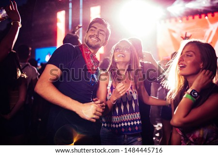 Cheerful crew dancing together and an outdoors festival #1484445716