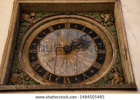 City clock on the wall of an old church in Tallinn. Estonia.  #1484505485