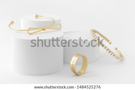 Golden girl accessories two golden bracelets and ring on white background #1484525276