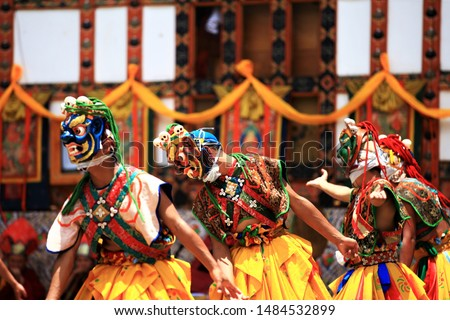 Bhutan dance(tibet dance),Close up Traditional dance and colors in Mongar, Bhutan ,masked dancers at a Buddhist religious ceremony,happy holiday #1484532899