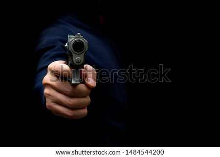 Man Carrying a Toy Gun to Rob the Money. Robber in the Shadow with Toy Gun Rob Money. Concept Picture.