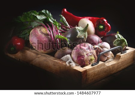 Fresh harvested vegetables in wooden box. Trendy ugly organic food #1484607977