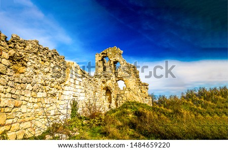 Ancient ruin of stone fortress wall. Ruined wall in ruin city Royalty-Free Stock Photo #1484659220