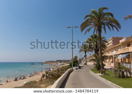 Mil Palmeras Costa Blanca Spain with palm trees and apartments and beach in beautiful summer sunshine #1484784119