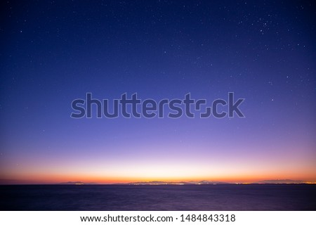 Starry sky with early morning light.  Royalty-Free Stock Photo #1484843318