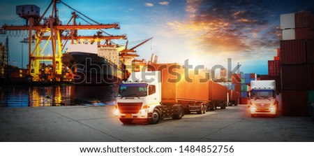 Container truck in ship port for business Logistics and transportation of Container Cargo ship and Cargo plane with working crane bridge in shipyard at sunrise, logistic import export and transport #1484852756