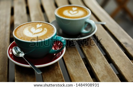 Two cup of coffee on wooden background, breakfast morning concept in cafe #1484908931