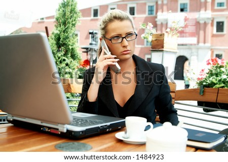 Business women working with laptop computer and talking cell phone #1484923