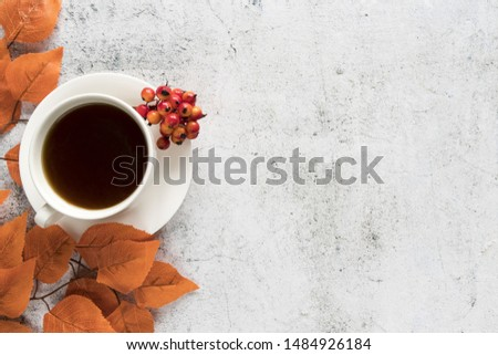Drink with autumn leaves on light surface #1484926184