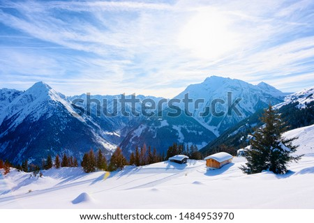 Panorama of ski resort town Mayrhofen with chalet houses in Tyrol in Zillertal valley in Austria in winter Alps. Landscape and cityscape with Alpine mountains with white snow. View from Penken park #1484953970