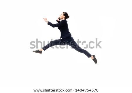 beautiful businesswoman levitating while talking on smartphone isolated on white #1484954570