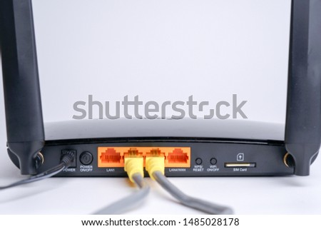 WiFi Modem Router ADSL connected with LAN RJ45 Cable. It is a LAN network connection ethernet cable. Internet cord RJ45 #1485028178