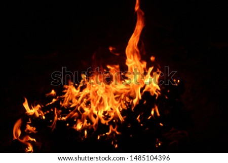 The flames of flaming flames swept through various shapes like hot, energy on a black background. #1485104396