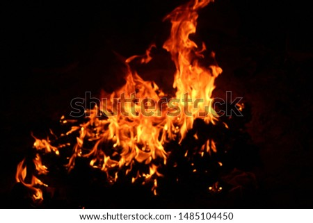 The flames of flaming flames swept through various shapes like hot, energy on a black background. #1485104450