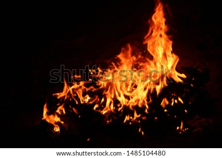 The flames of flaming flames swept through various shapes like hot, energy on a black background. #1485104480
