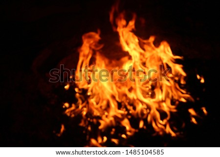 The flames of flaming flames swept through various shapes like hot, energy on a black background. #1485104585