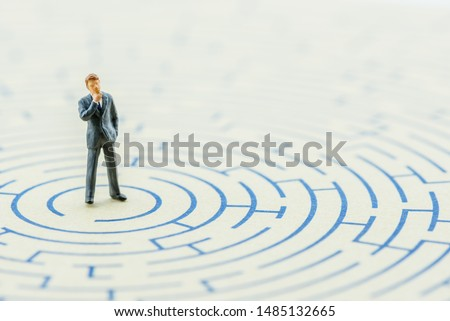 Business long-term decision, problem solving concept : Businessman thinks, find or searches for a way or direction to get out from hard situation, depicts complex strategy to escape from bad scenario #1485132665