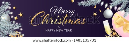 Merry Christmas and Happy New Year design with sparkling silver light bulbs, presents and champagne glass on purple background. Lettering can be used for posters, leaflets, announcements #1485135701